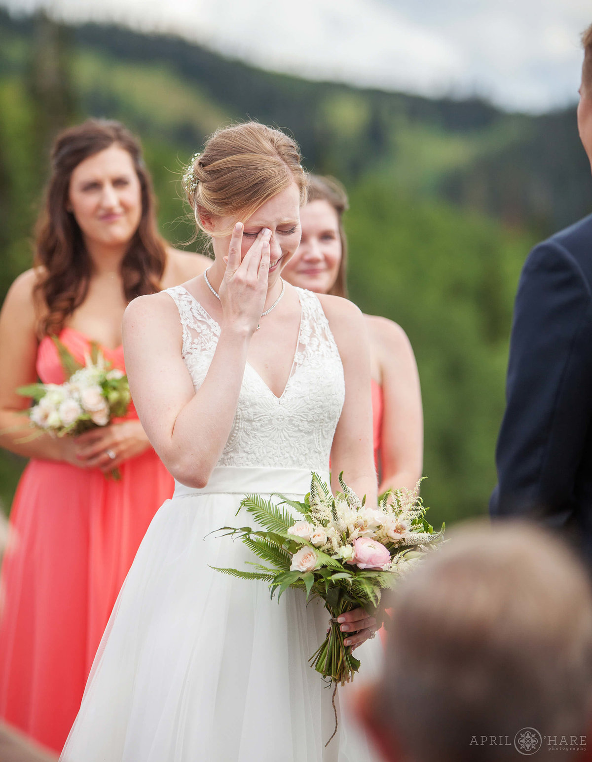 Bride cries at her beautiful outdoor Steamboat Springs Wedding ceremony in Colorado