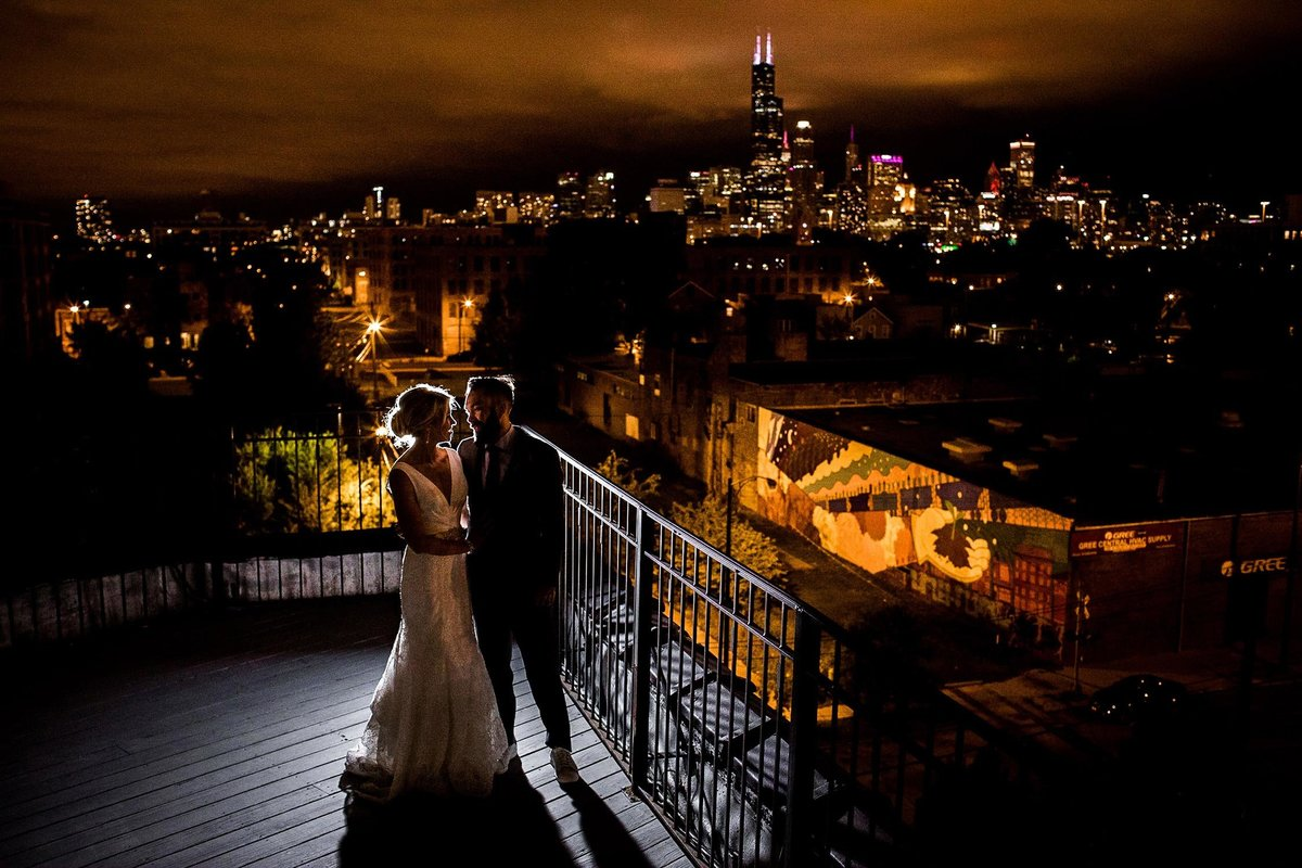 A couple embraces on the rooftop during their Lacuna Artist Lofts wedding.