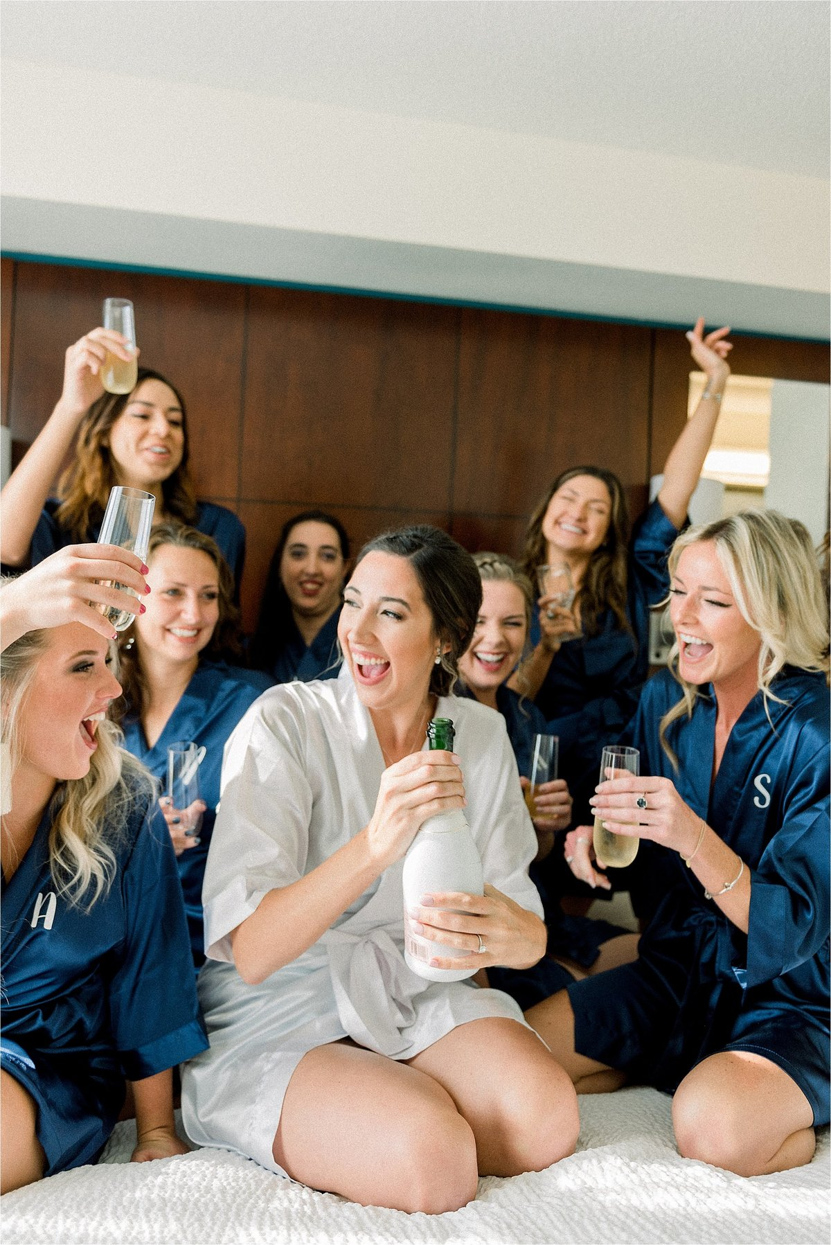 A bride toasting champagne with her bridesmaids at her Washington DC wedding