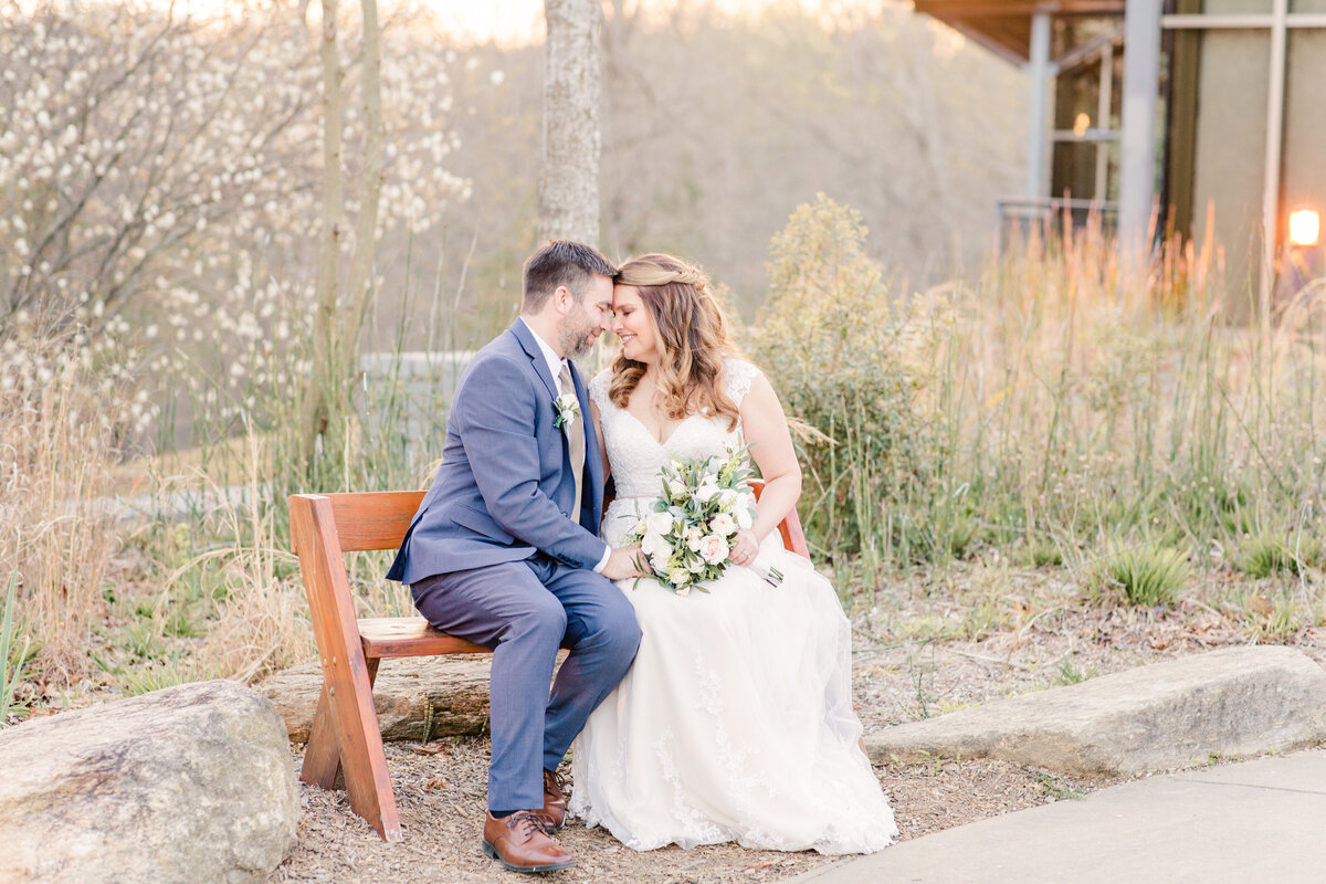 A couple at sunset at their wedding at the Gwinnett Environmental and Heritage Center by Jennifer Marie Studios, Atlanta wedding photographer.