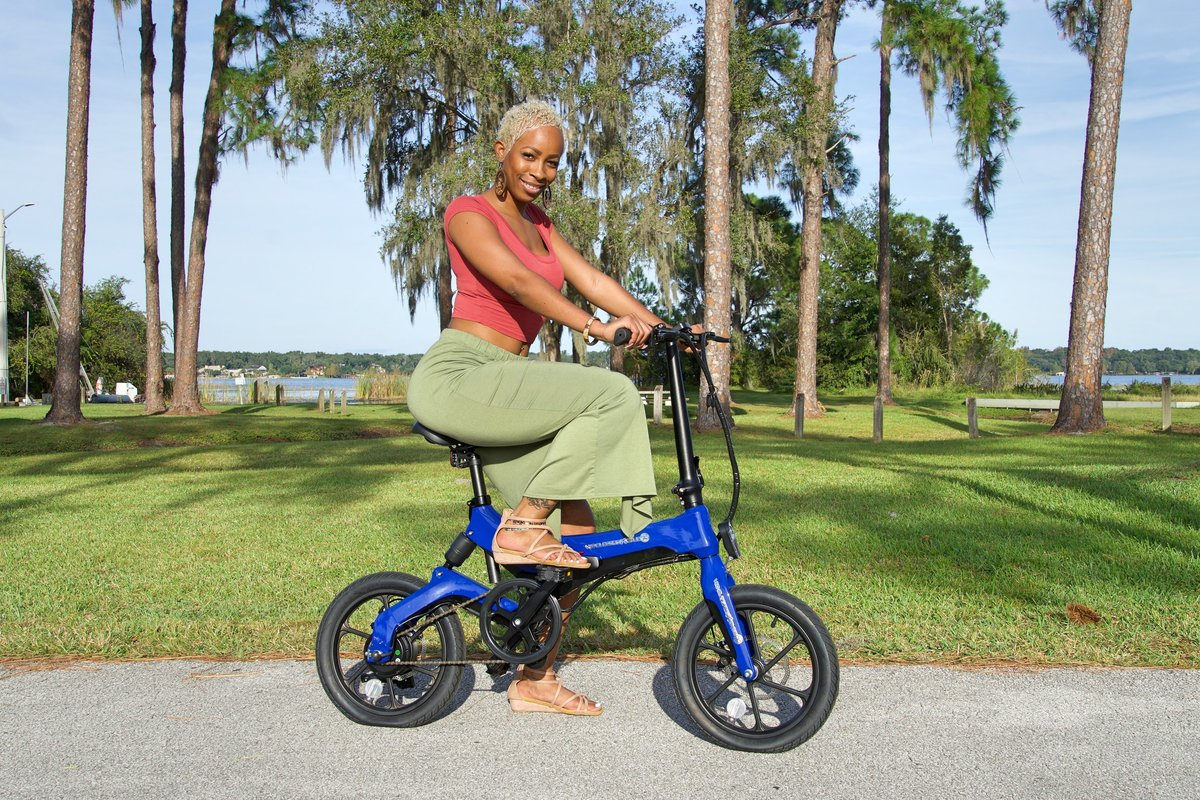 Lady riding Blue Go-Bike M4 in the park