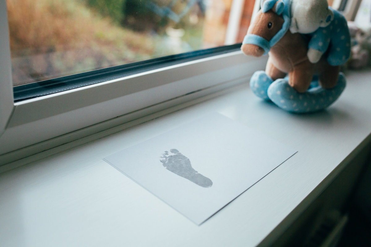 Candid photo of toddler footprint on paper