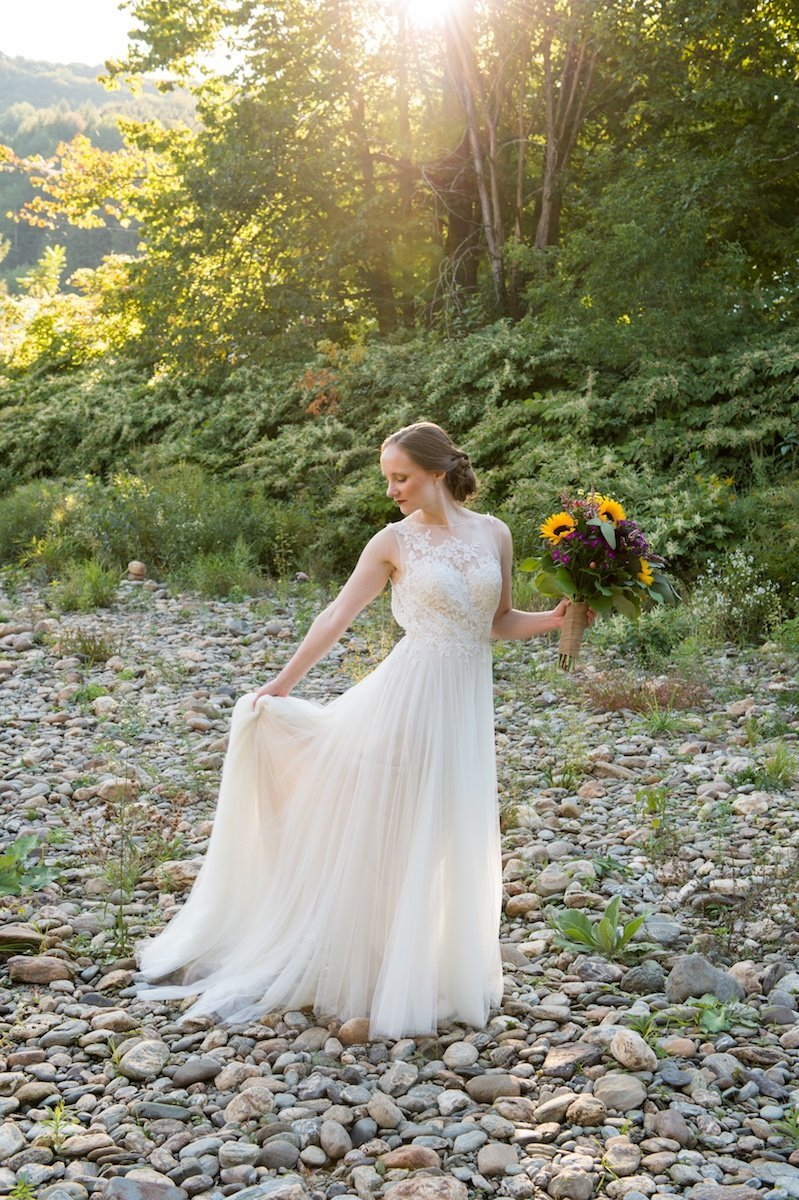 bridal portrait by river in Vermont