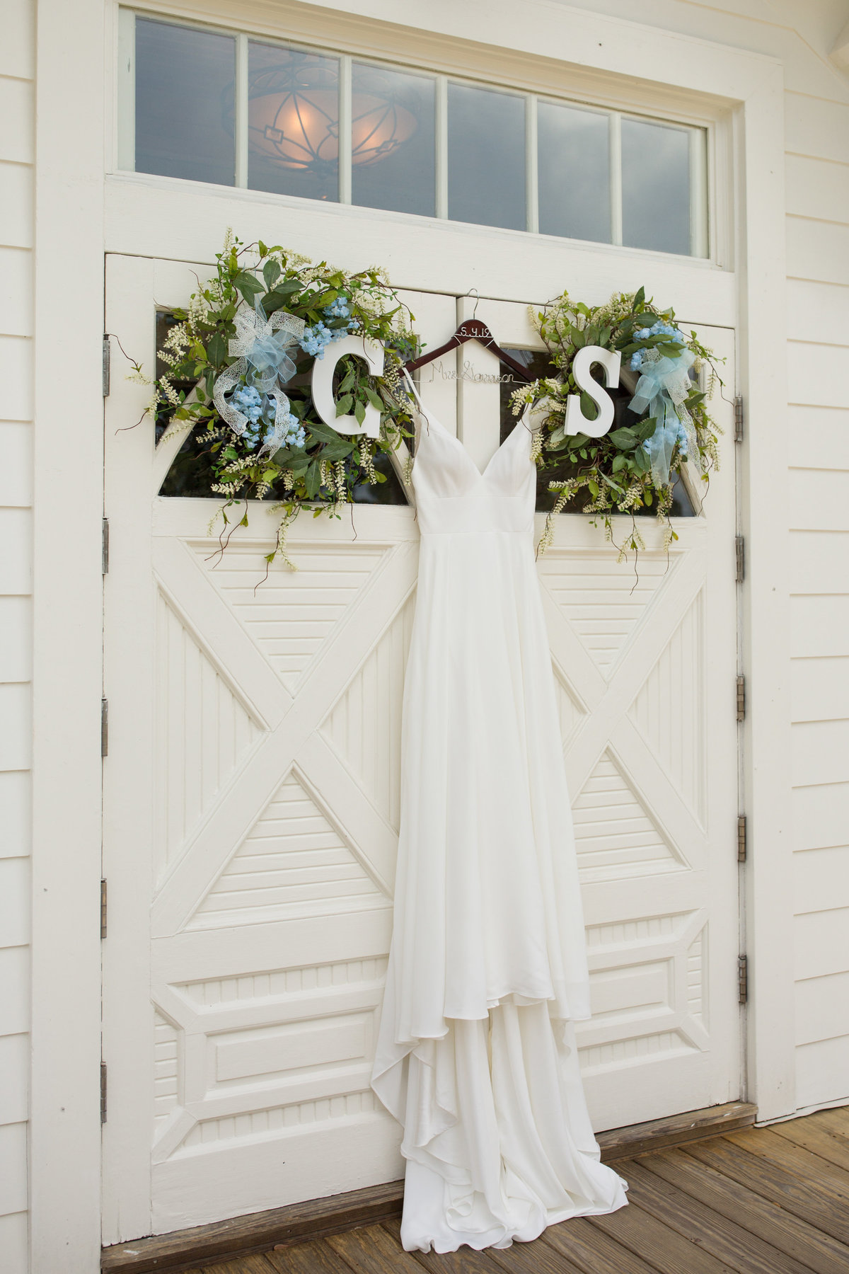 dress hanging on door of tybee chapel