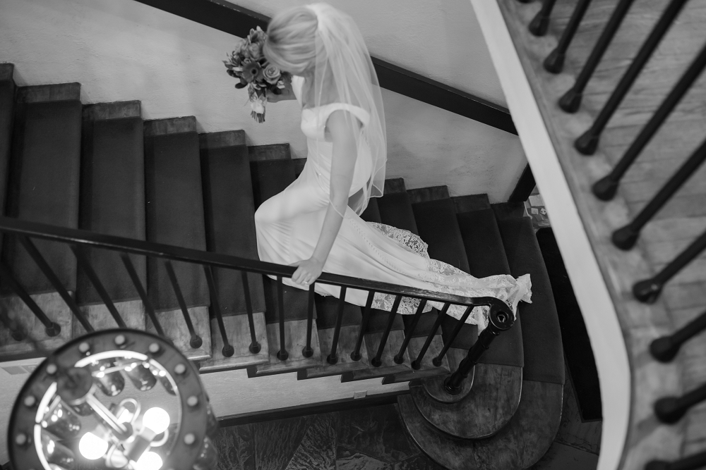DESTINATION WEDDING IN TRAVERSE CITY WITH KRISTEN AND SCOTT Bride on Staircase