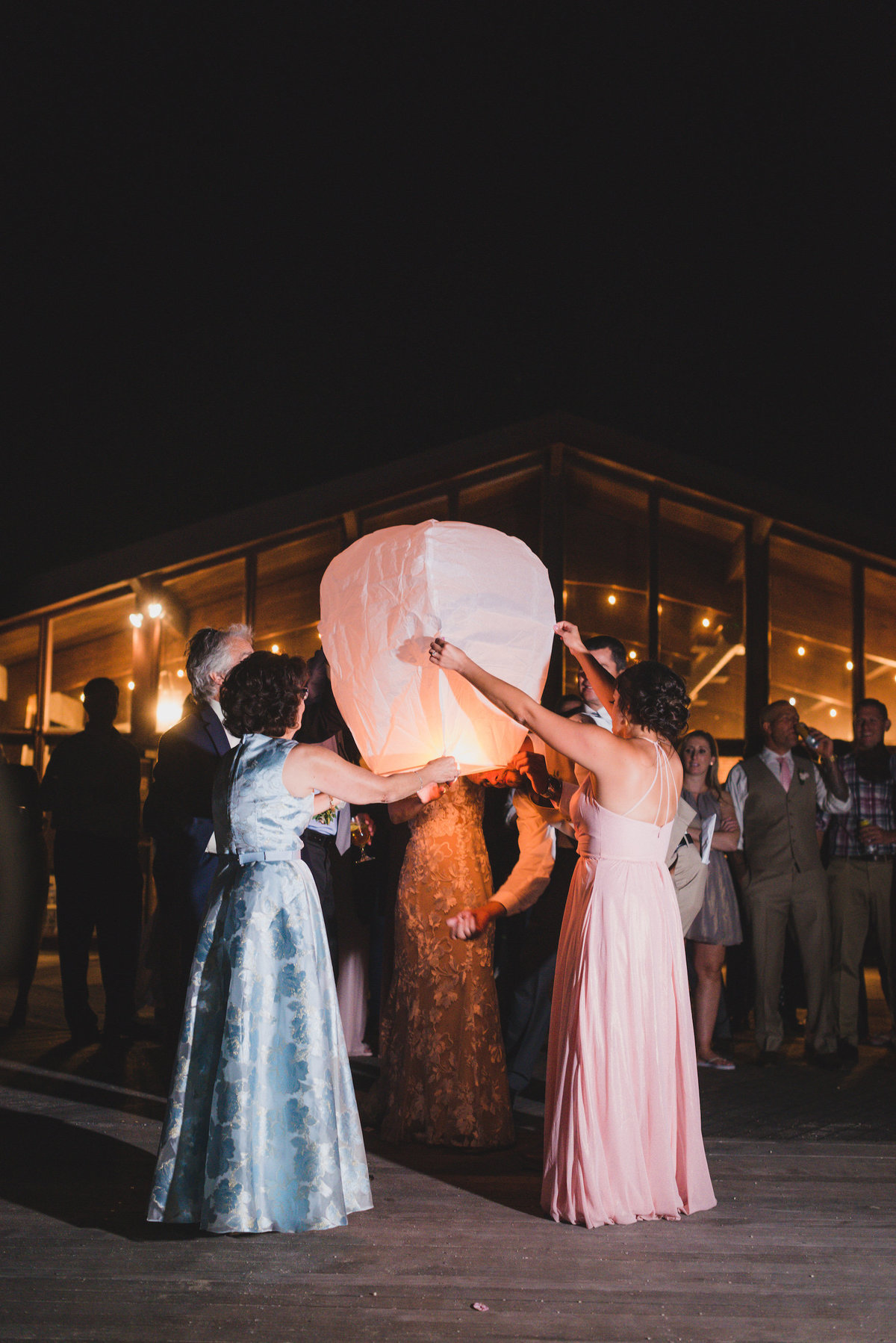 night shot of bridal party before sparklers from beach wedding at Pavilion at Sunken Meadow