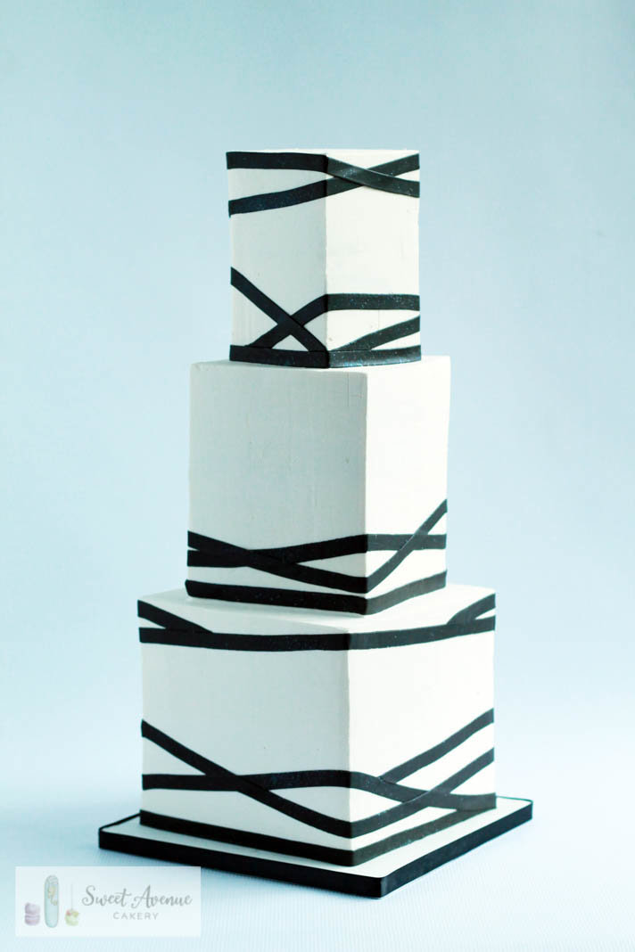 geometric white square wedding cake with black stripes