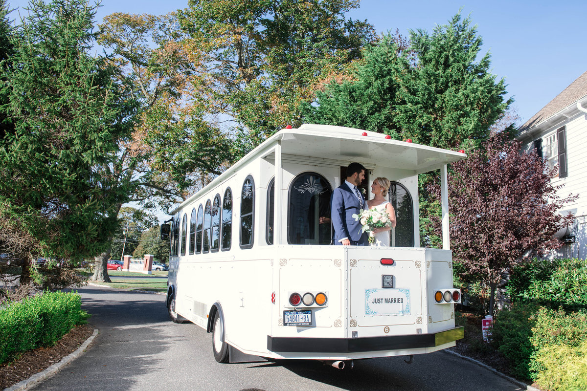 photo of bride and groom on trolly from wedding at Mansion at Timber Point