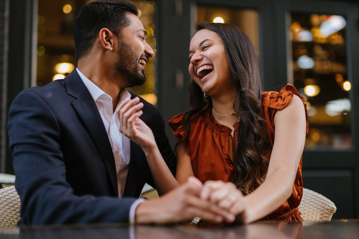 Engagement photography session by Expose The Heart of Indian man and Hispanic woman laughing and in love at the Historic Pearl Brewery.