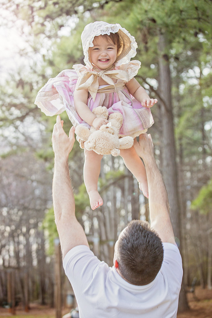 charlotte family photographer jamie lucido captures beautiful father daughter portrait, child laughing in the air above father