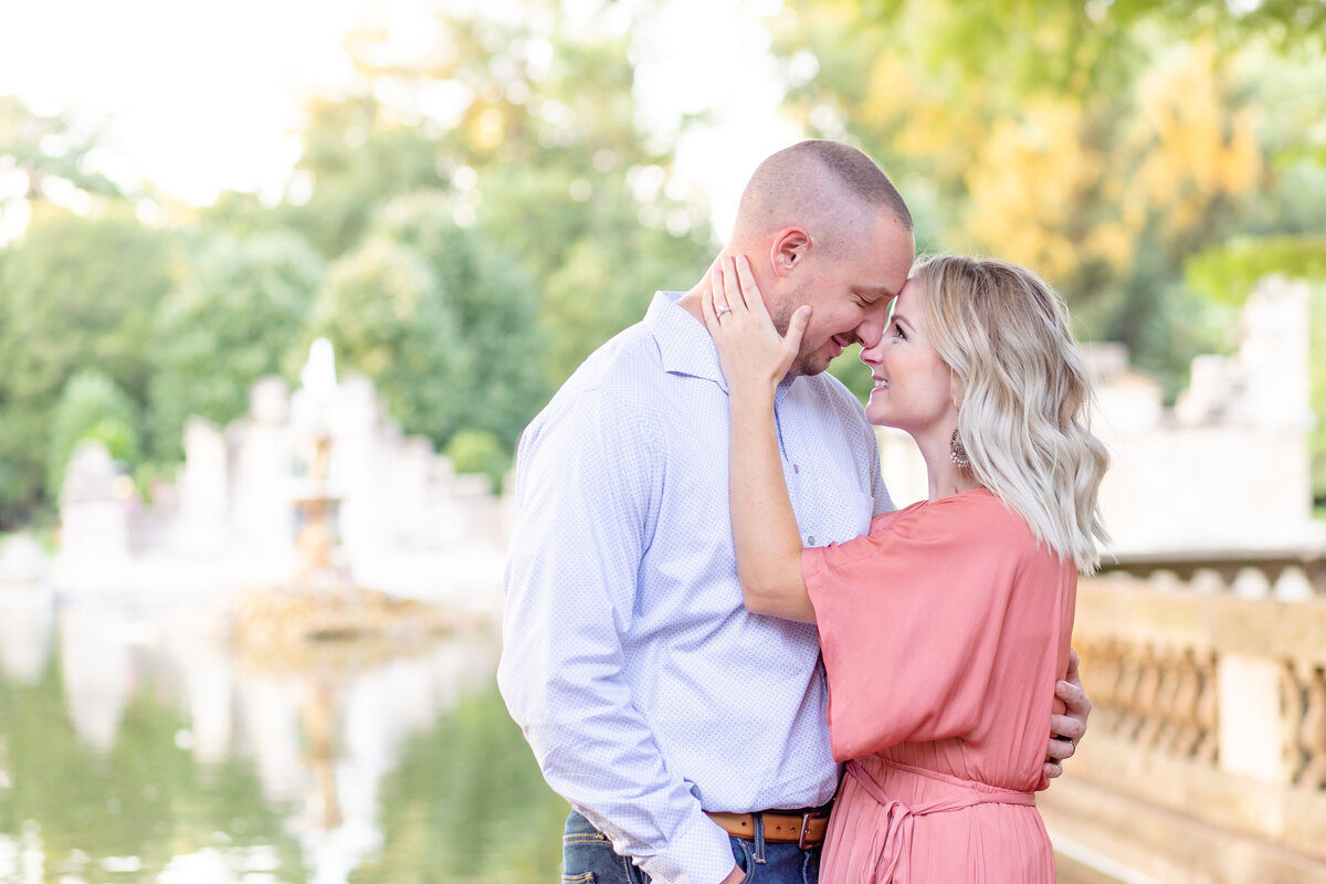 Summer Sunset Engagement Session with pink maxi dress couple  by water  at The Ruins  in Tower Grove Park in St. Louis by Amy Britton Photography Photographer in St. Louis