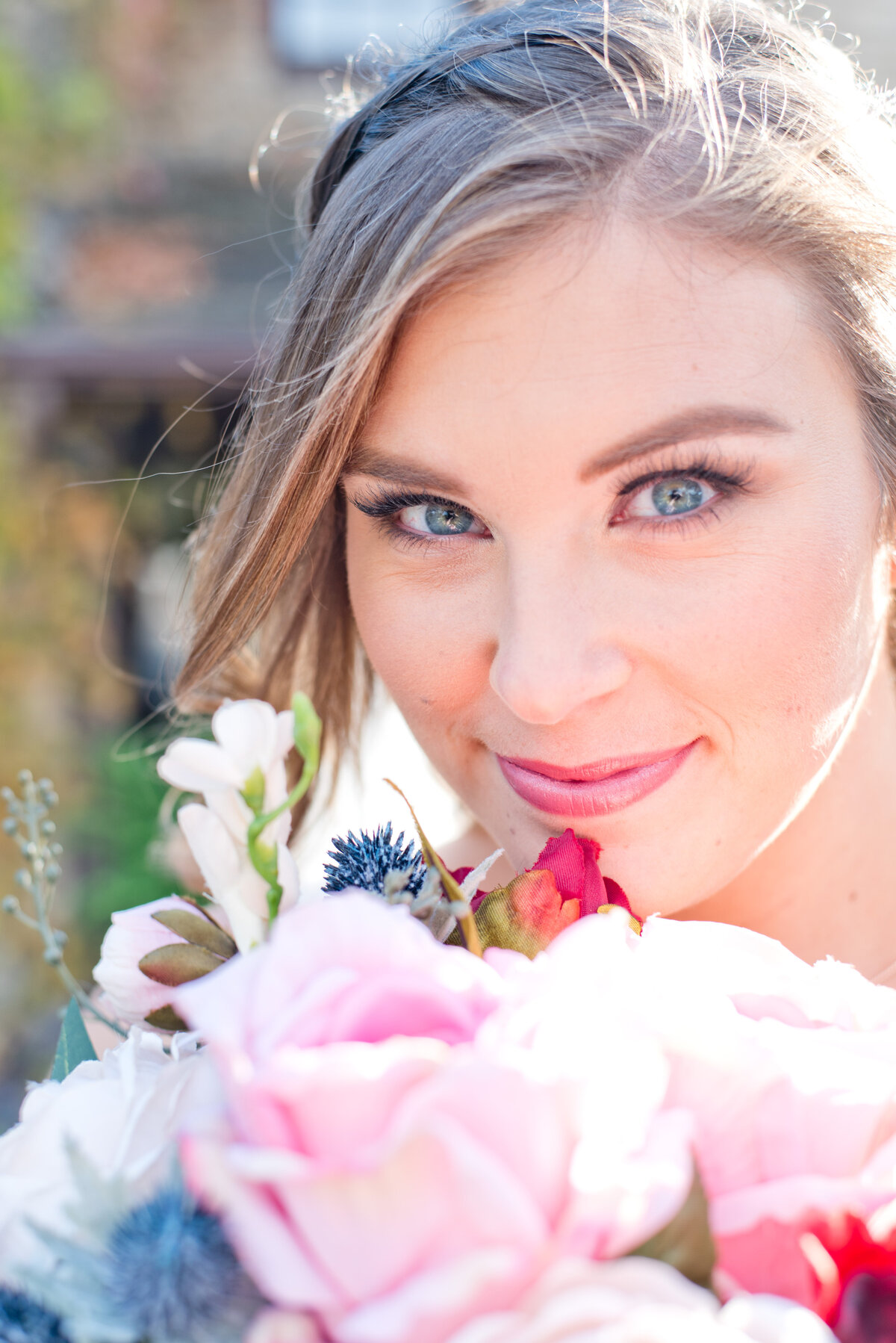 Fort Worth bride holding colorful bouquet and smiling