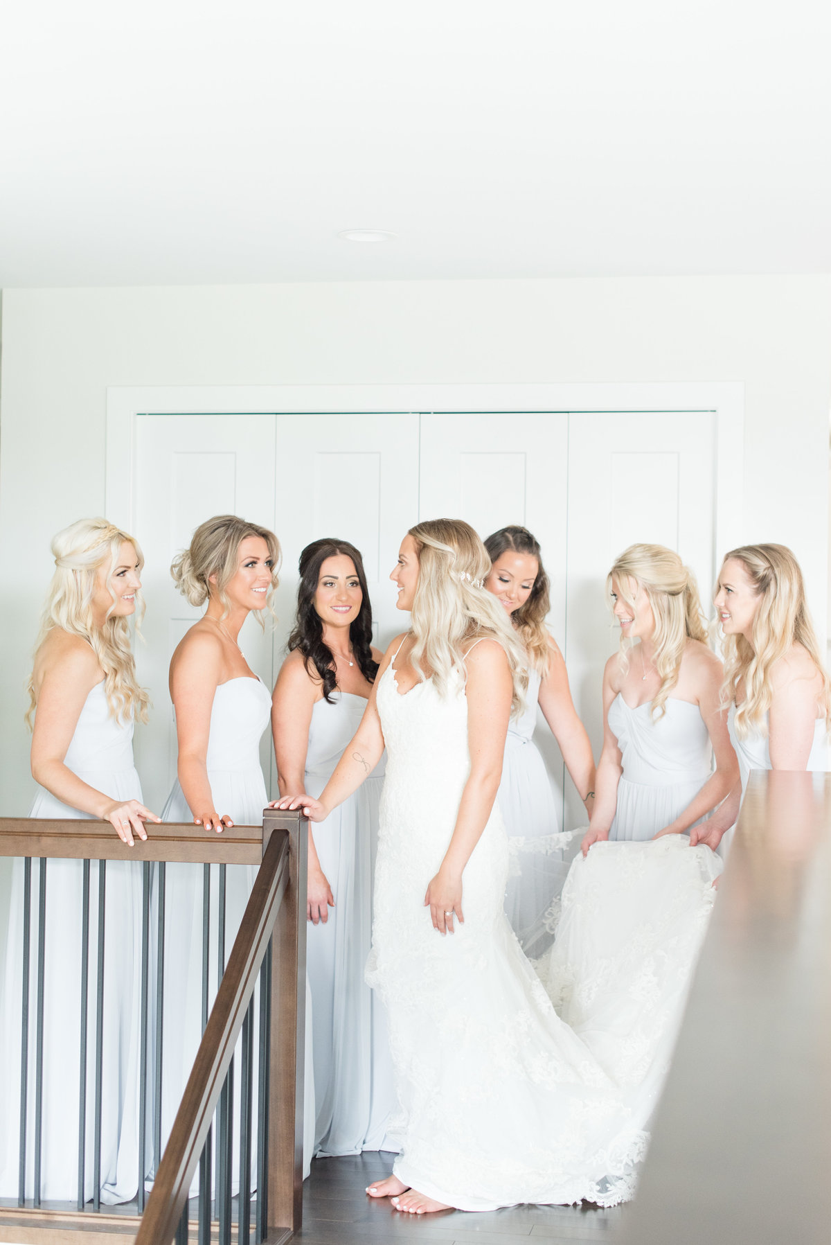 A bride gets ready on the morning of her Fort William Country Club wedding with the help of her bridesmaids