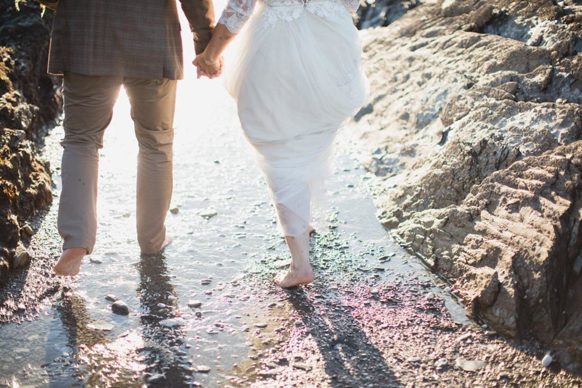 Bride and Grooms feet in the sea at Tunnels Beaches Devon