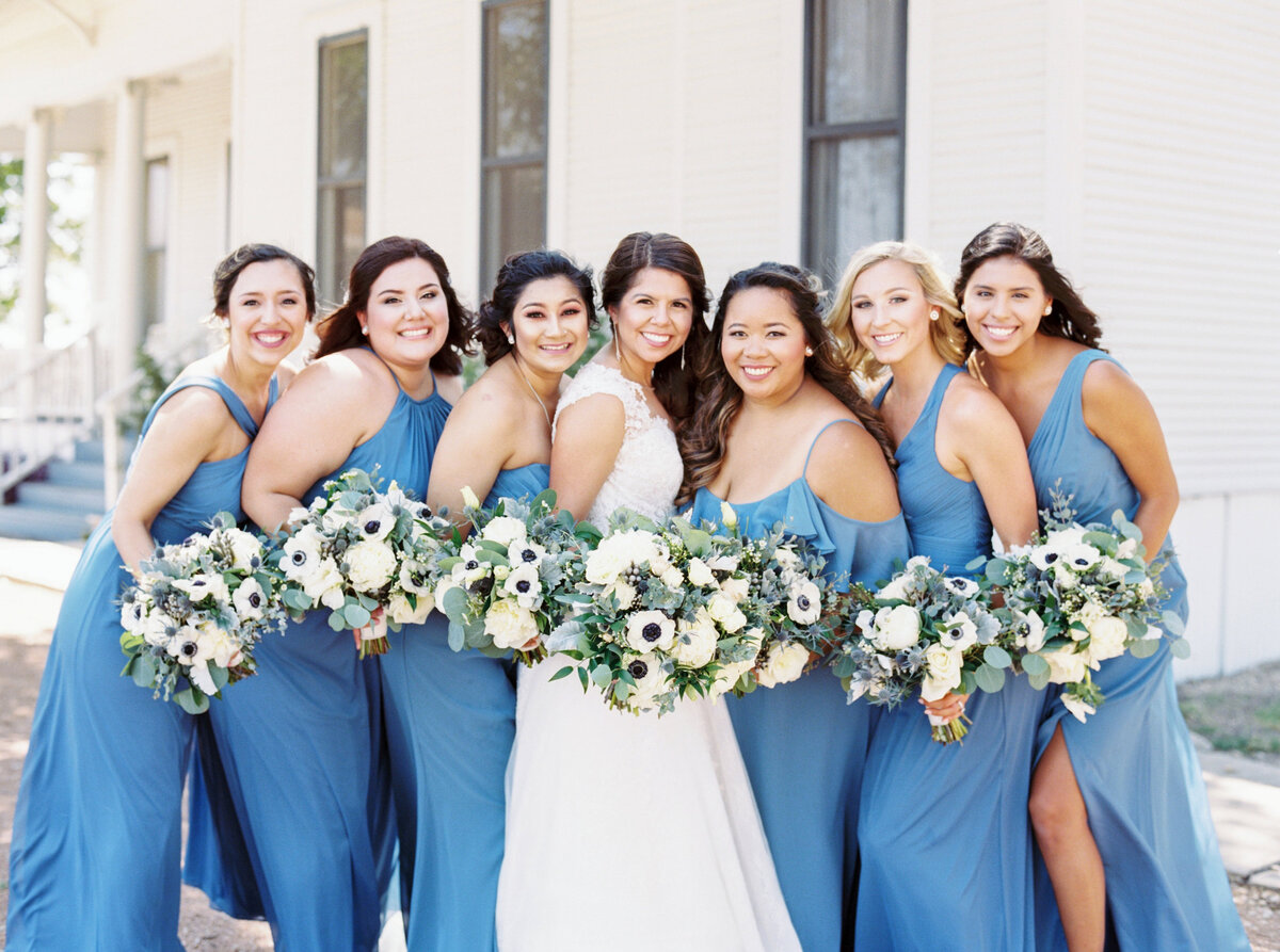 Bridesmaids in light blue with white bouquets