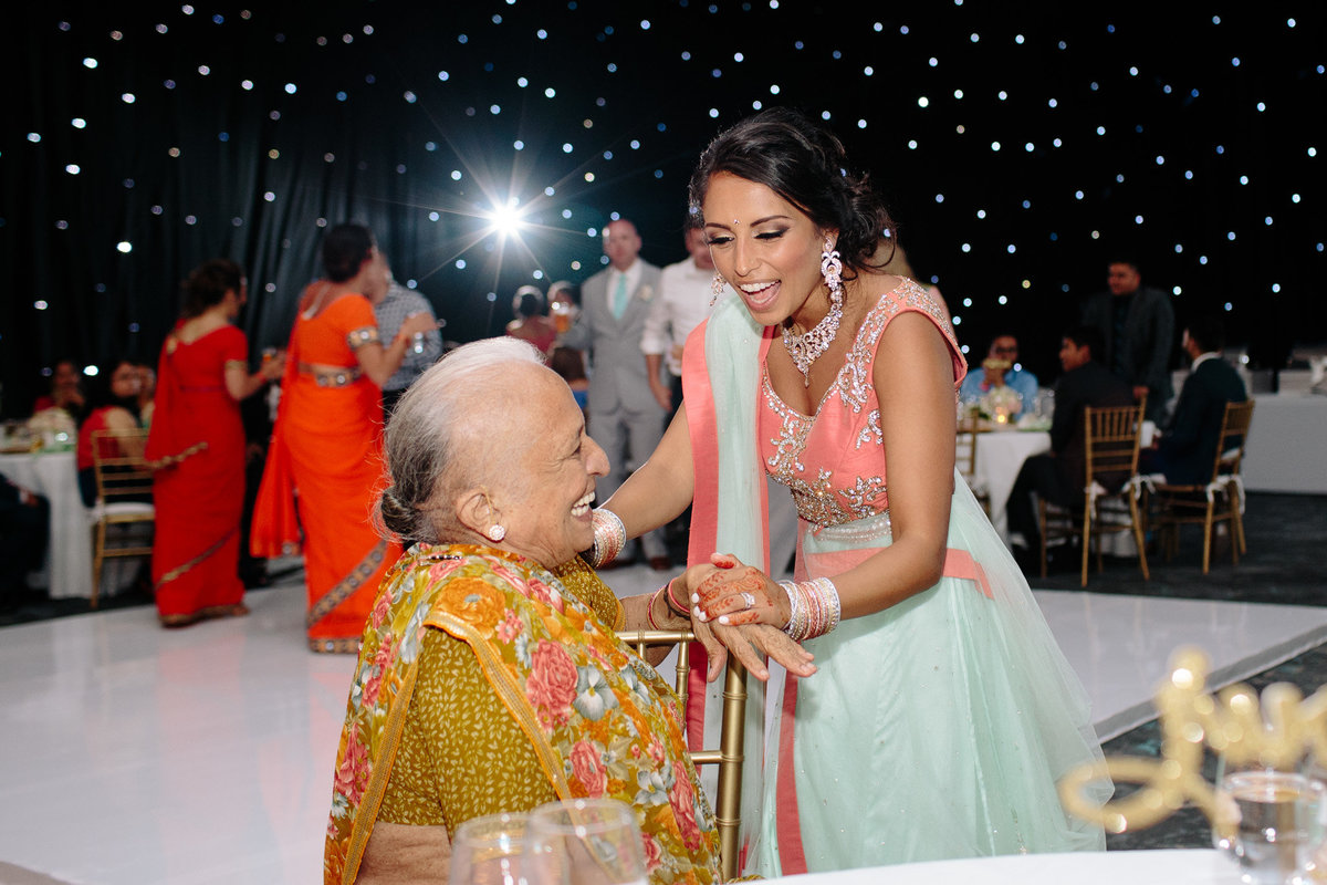 Candid emotion between a bride and her grandmother.  Authentic moment captured by Rebecca Cerasani