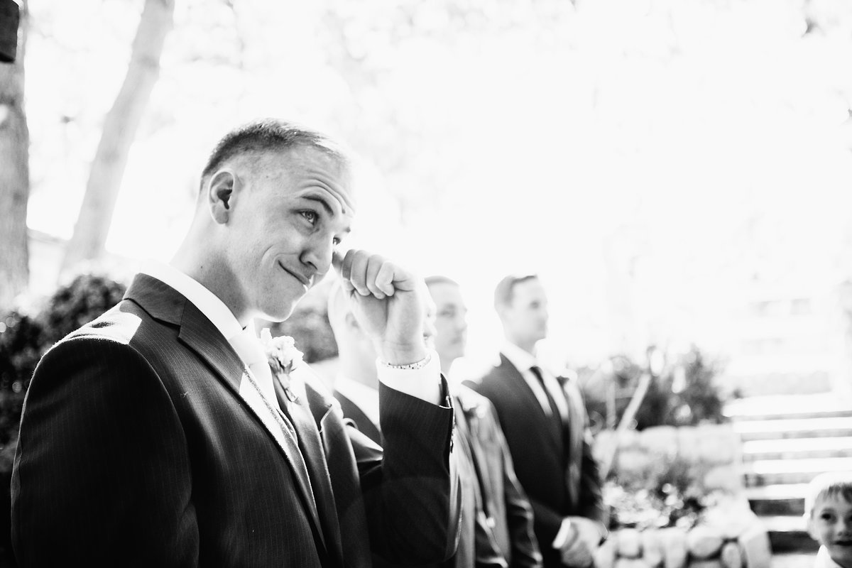 Lake Tahoe wedding pictures groom cries while bride walks down aisle