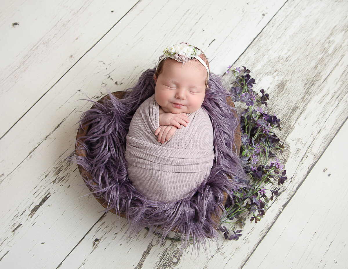 Newborn girl at our Rochester, Ny studio.
