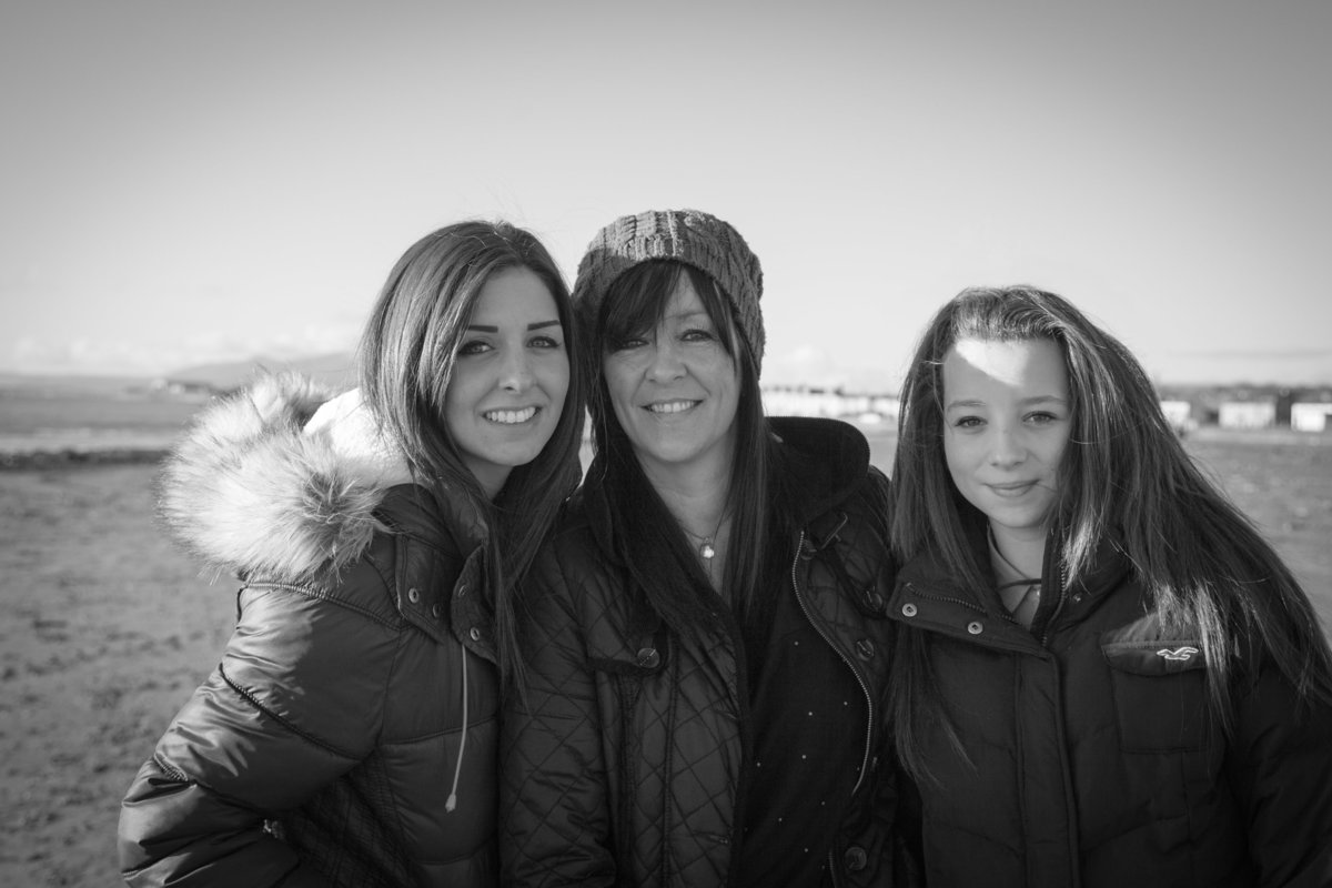Mum and daughters black and white portrait at beach