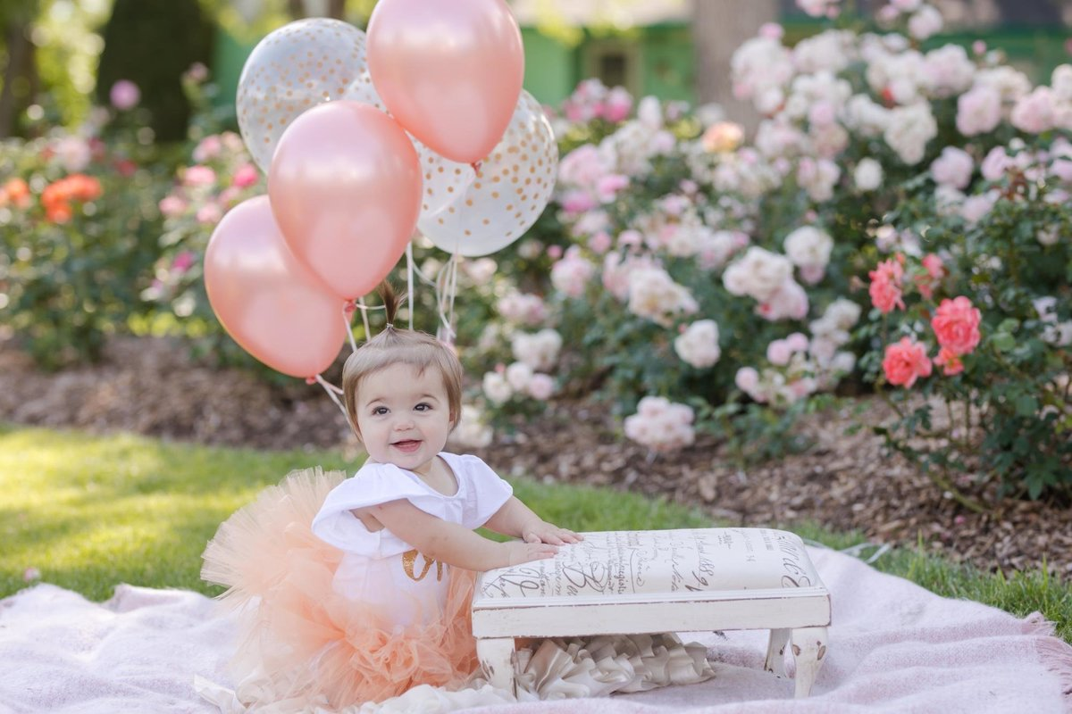 Baby girl outdoor cake smash