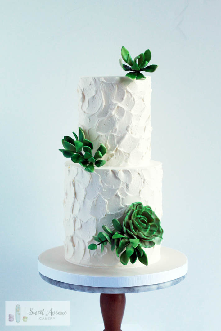 textured buttercream wedding cake with sugar succulents