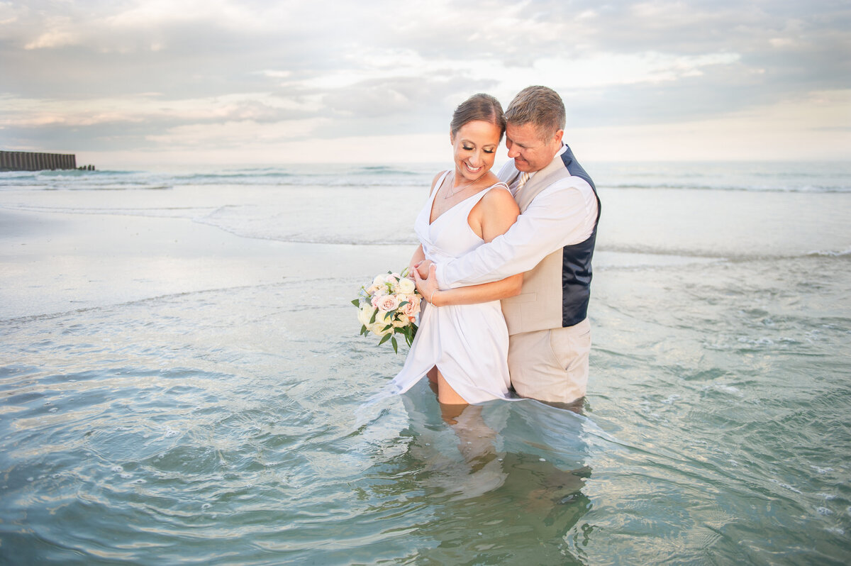 bride and groom portraits in ocean LBI
