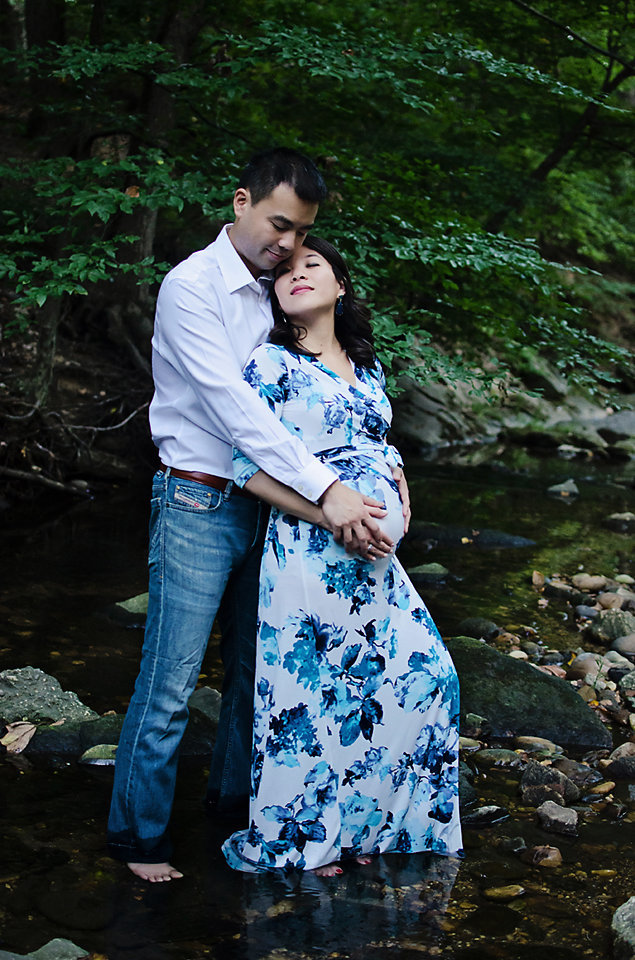 Maternity portrait in the creek with a beautiful dress at Lubber Run Park in Arlington, Virginia taken by Sarah Alice Photography