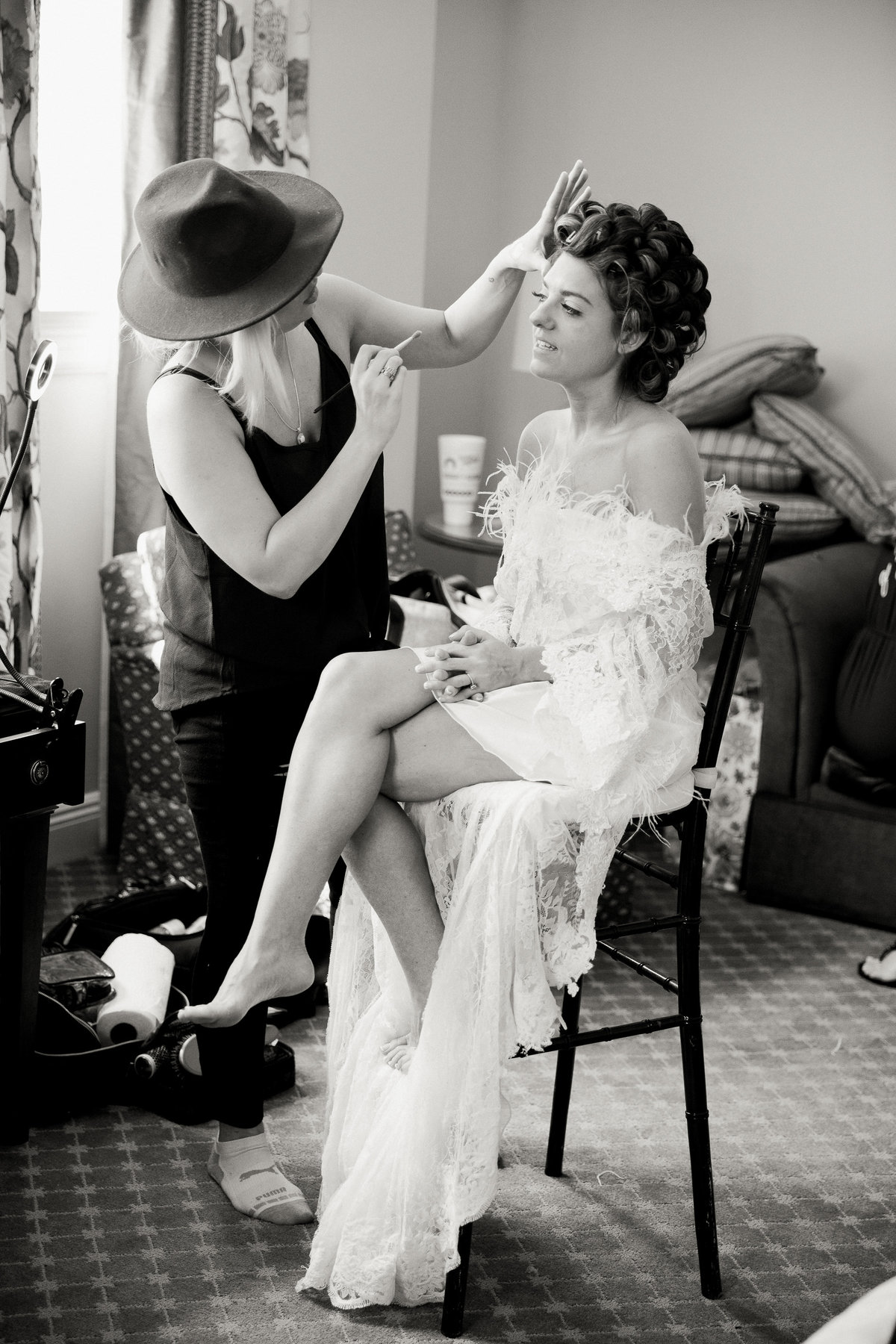 Bride makeup finishing touches.