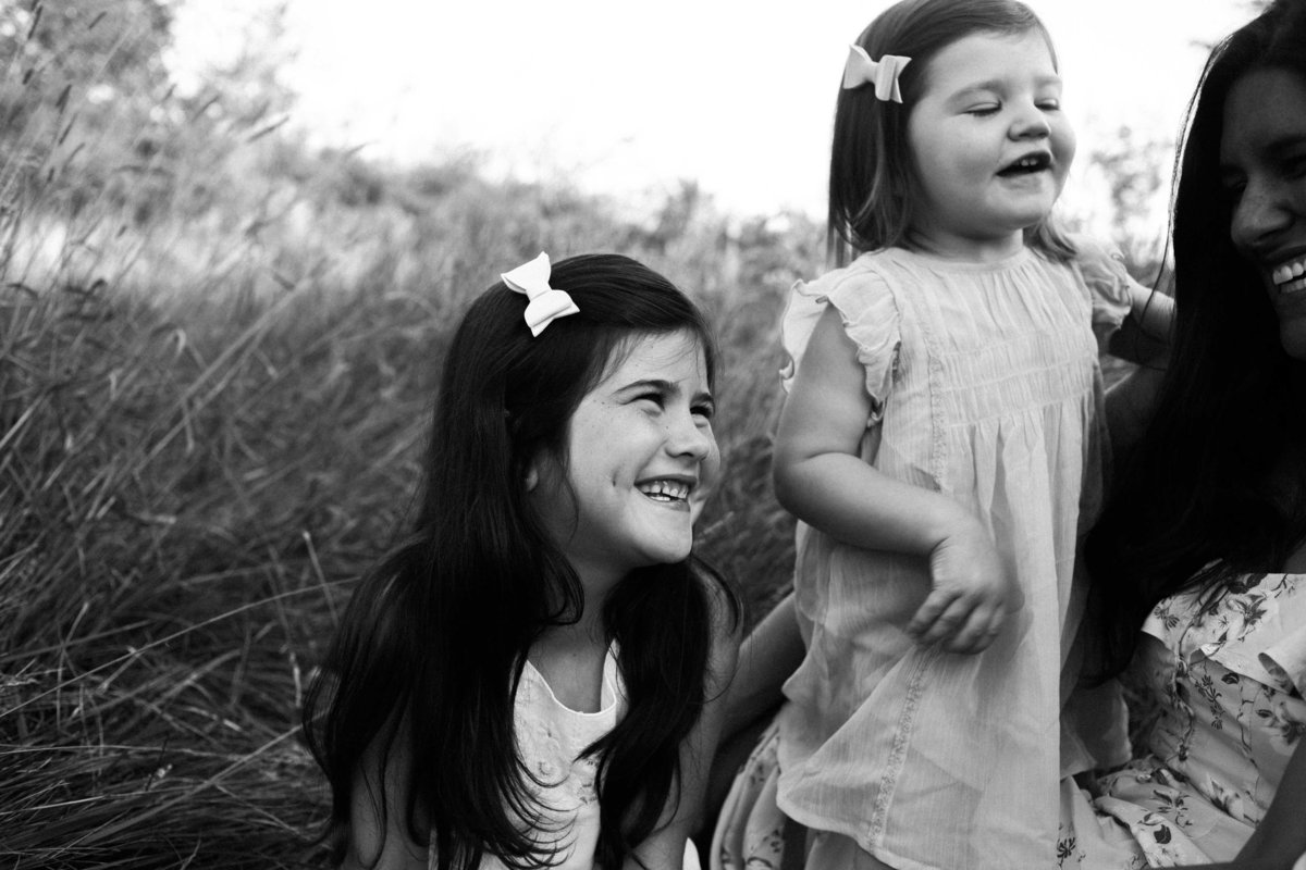 Little girl laughing with mom during sunset session with Elle Baker Photography