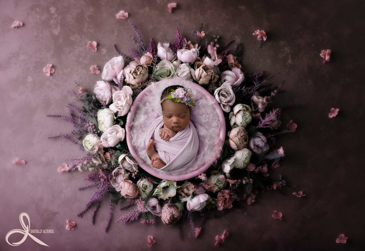 Little girl in a wreath of purple flowers