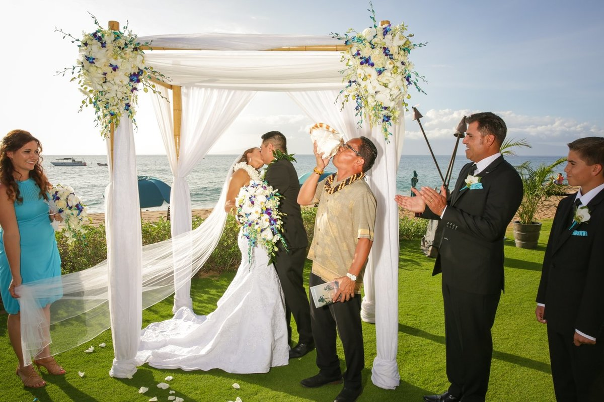Capture Aloha Wedding Kissing with friends, best man and maid of honor