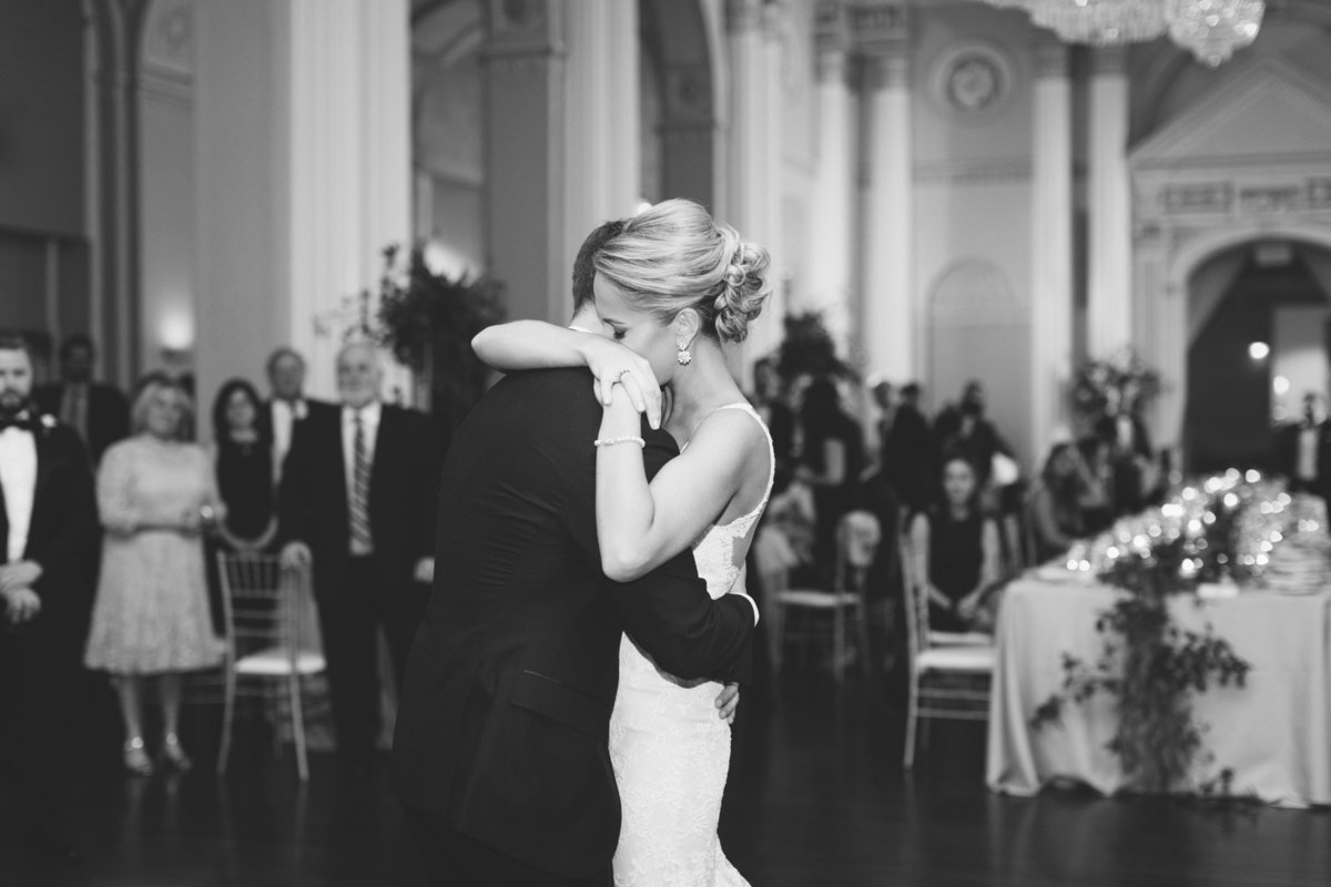 An emotional first dance of the bride and groom.  Real wedding photographed by Atlanta luxury photographer Rebecca Cerasani.
