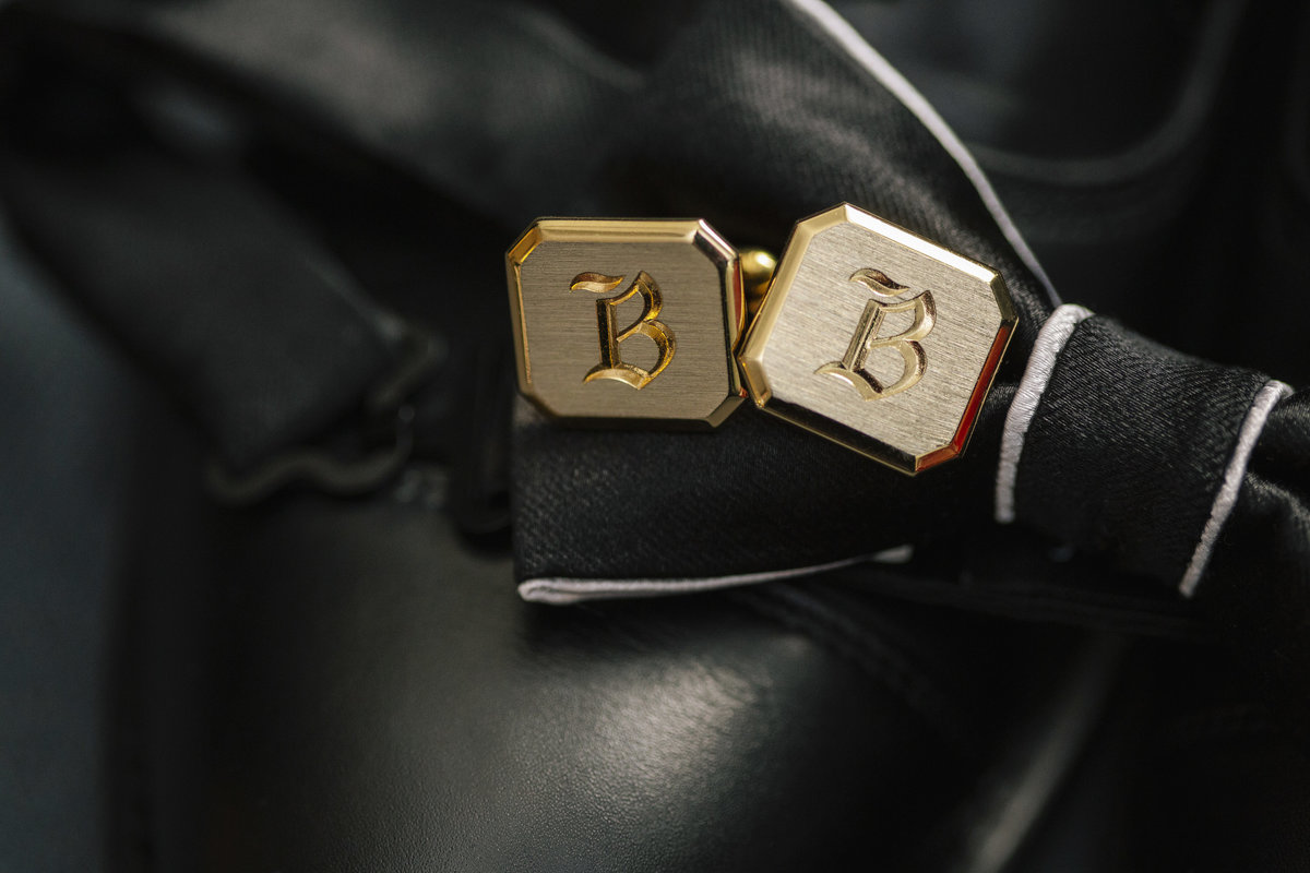 cuff links on bow tie before wedding