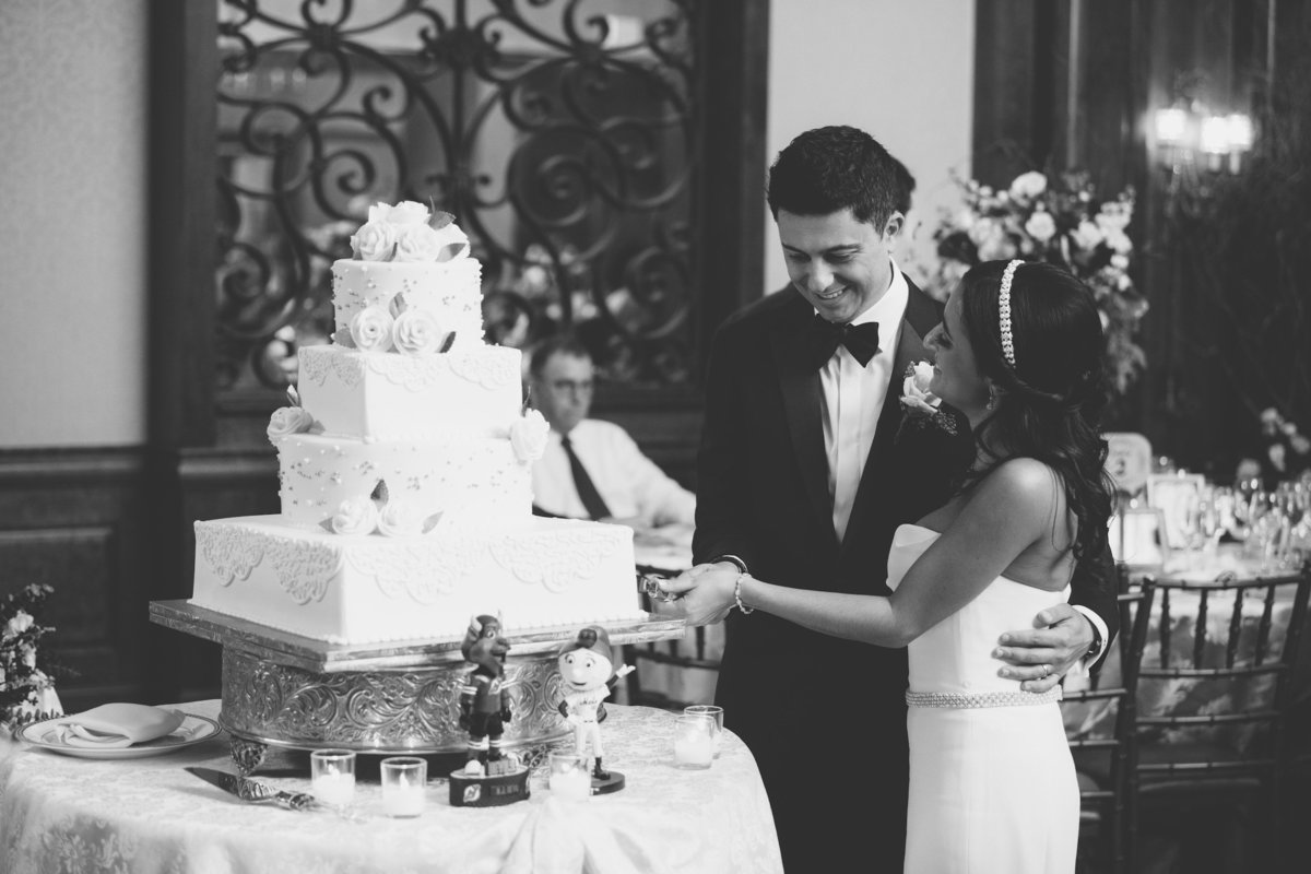 bride and groom cake cutting photo at Larkfield Manor
