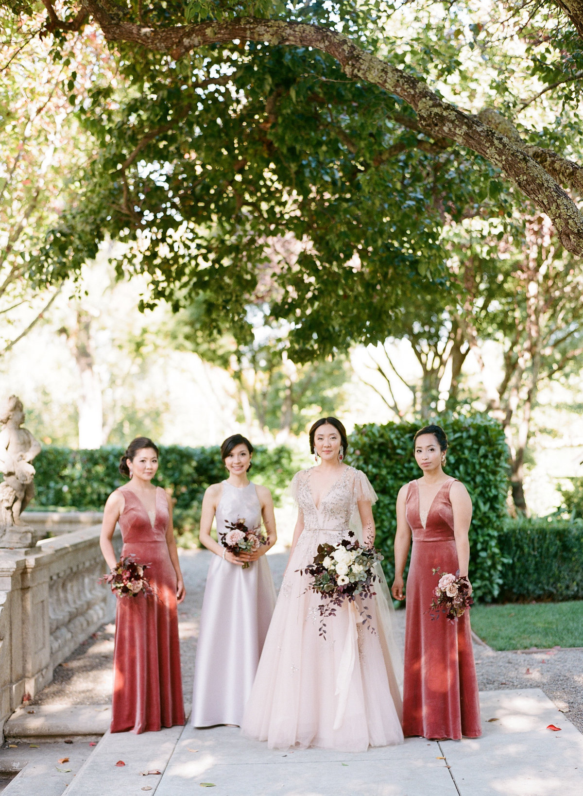 Bridesmaids for wedding by Jenny Schneider Events at the Beaulieu Garden in Napa Valley, California. Photo by Lori Paladino Photography.