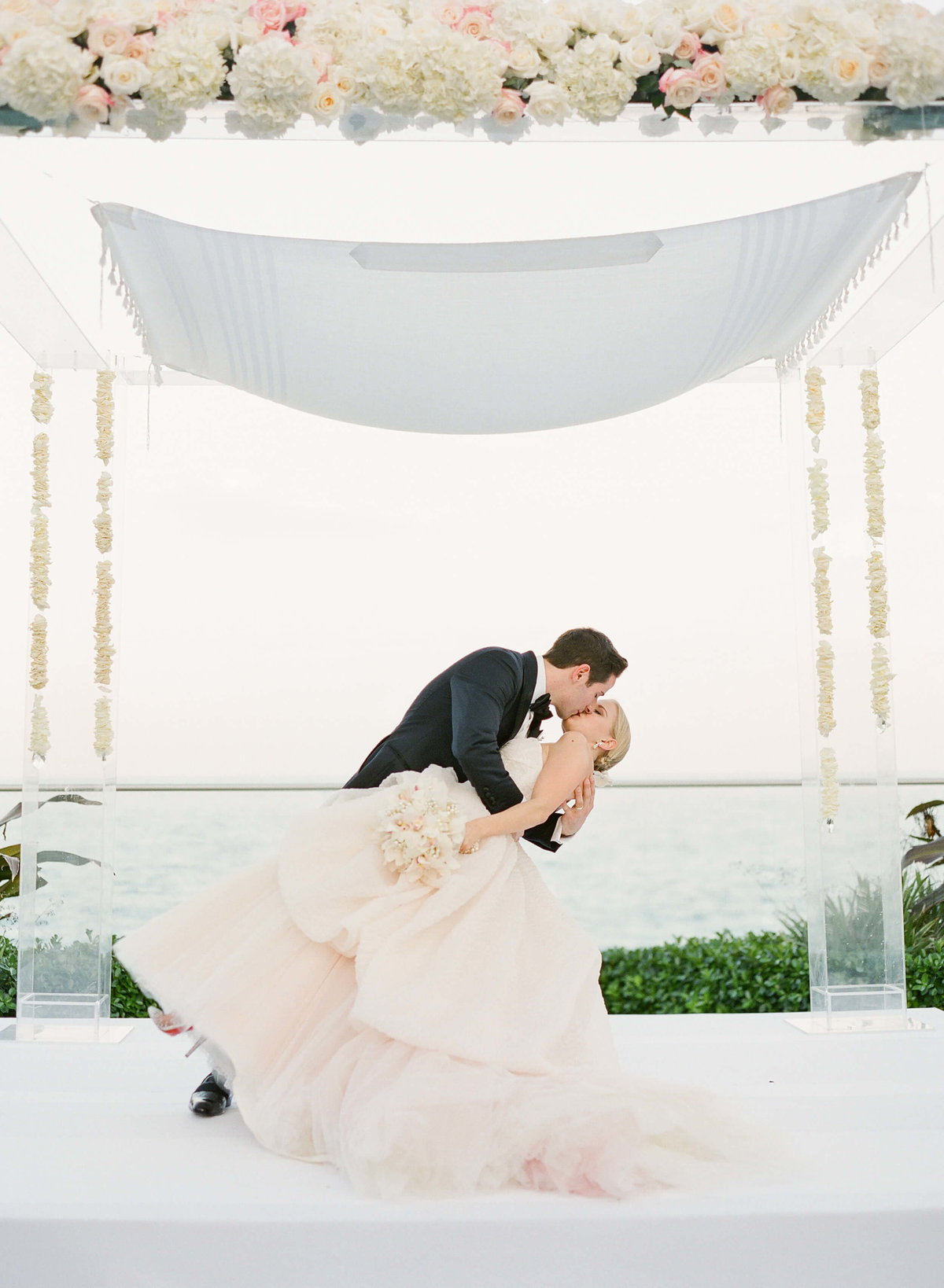 30-KTMerry-weddings-Palm-Beach-ocean-front-kiss