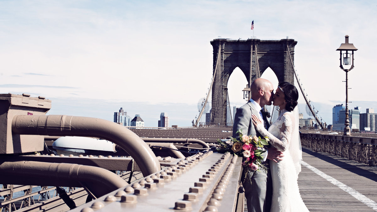 A Bride and Groom on Brooklyn Bridge in New York City