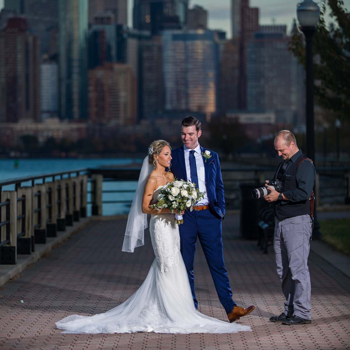 Travis with bride and groom behind the scenes outside NYC