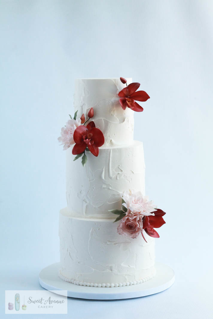 white textured buttercream wedding cake with burgundy sugar orchids, Hamilton ON wedding cakes