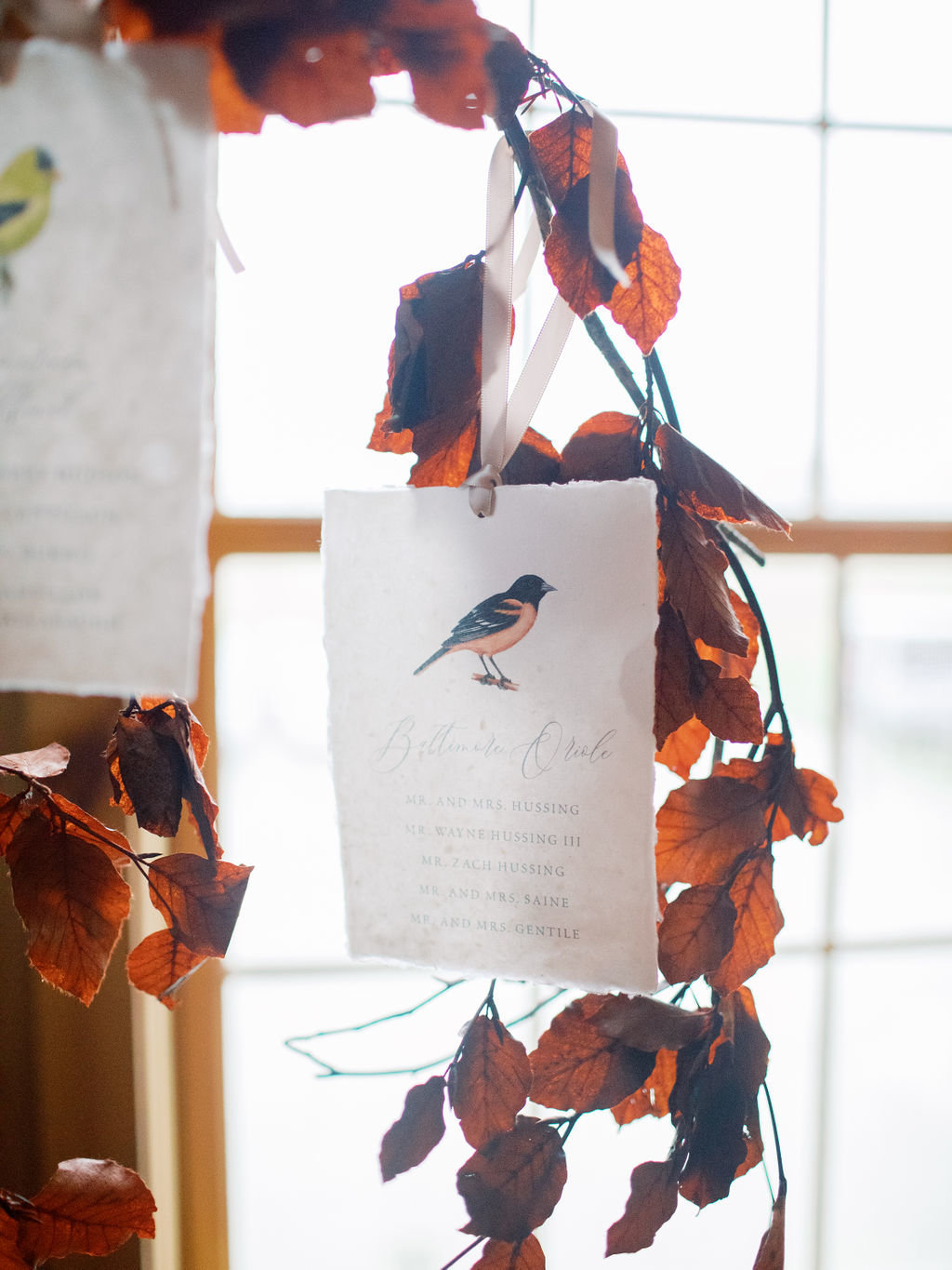 Fall wedding escort display bird