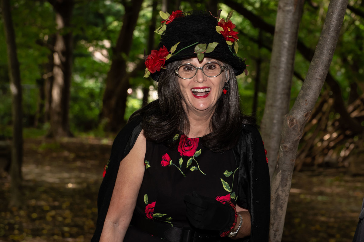 woman shows up to reception in crazy black flowered hat