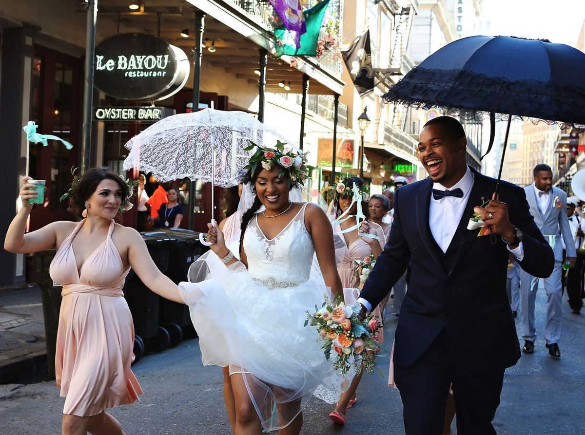 bride and groom with second line umbrellas