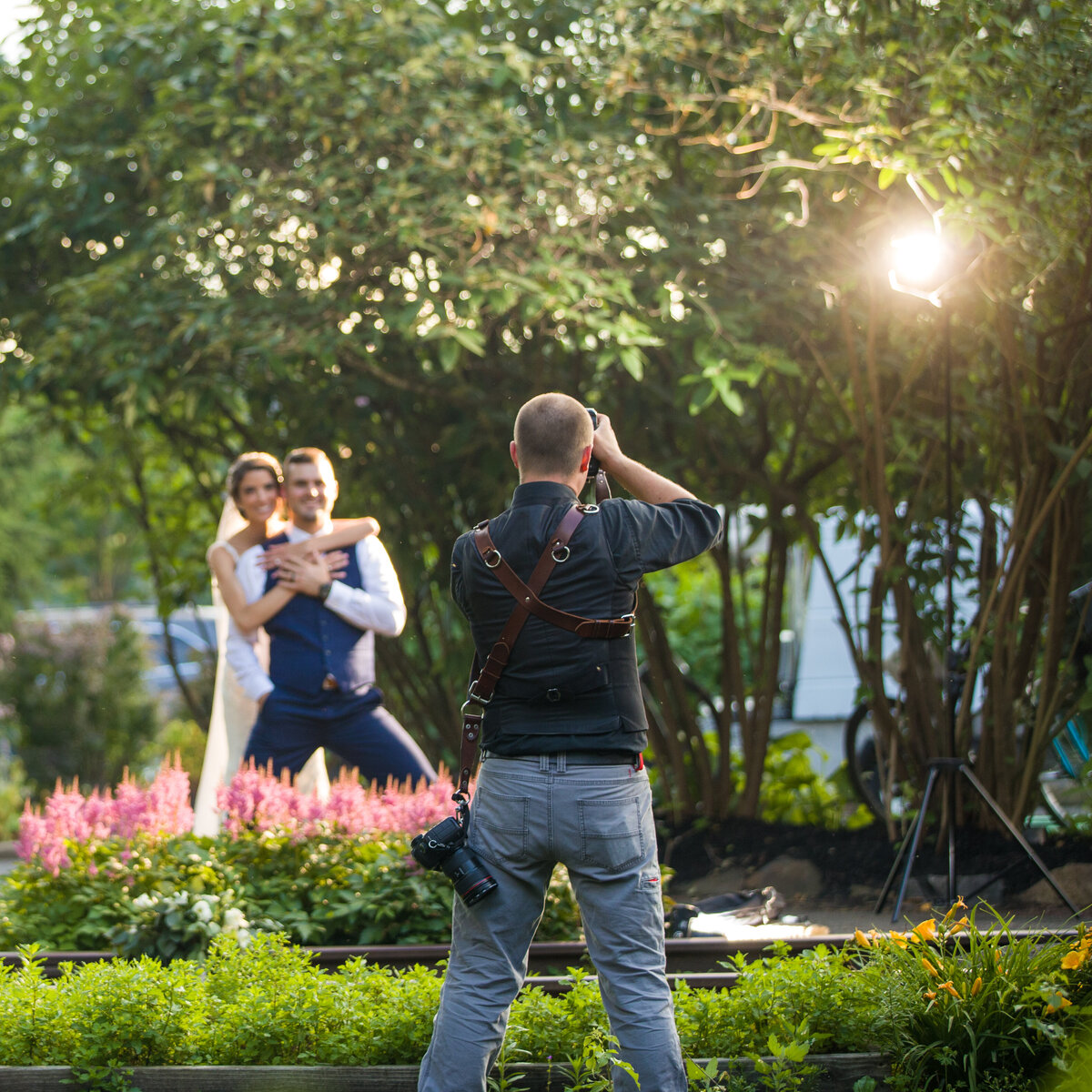 Travis photographs bride and groom behind the scenes on wedding day