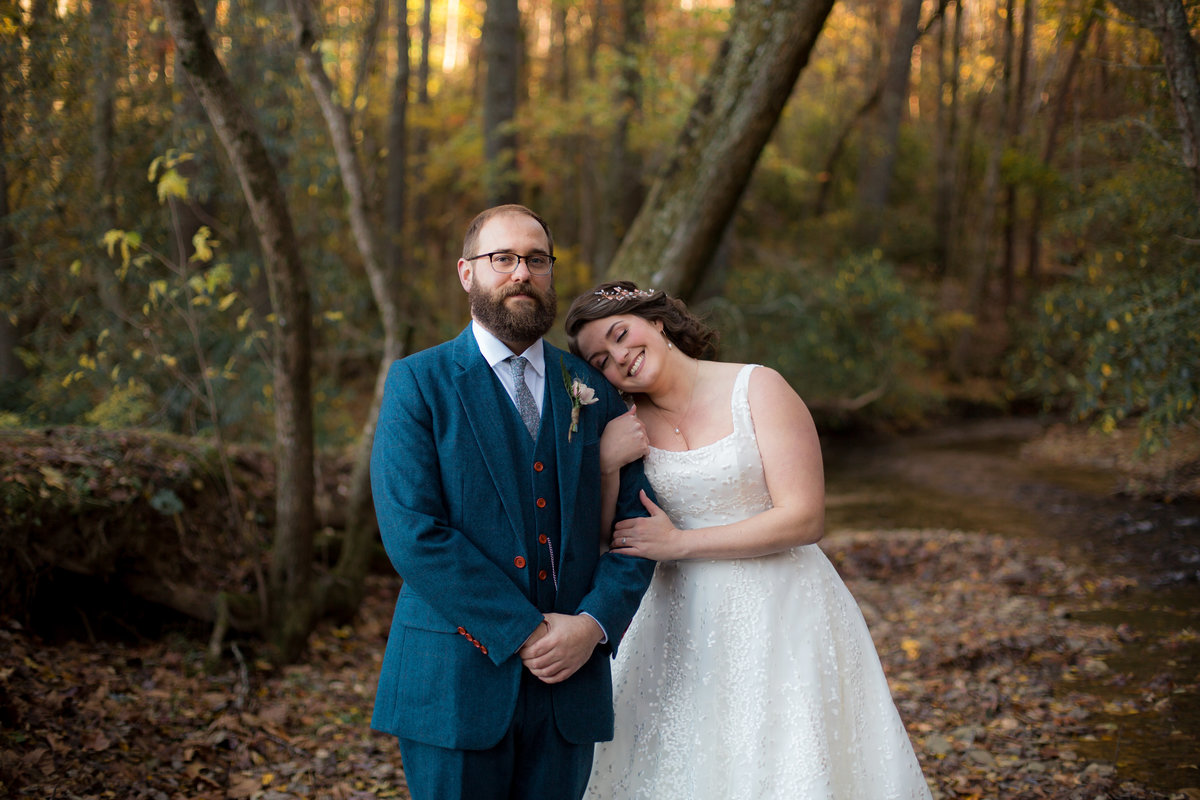 trendy bride and groom with beard outdoors in North Georgia mountains