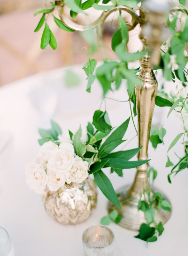 gold chandelier with greenery