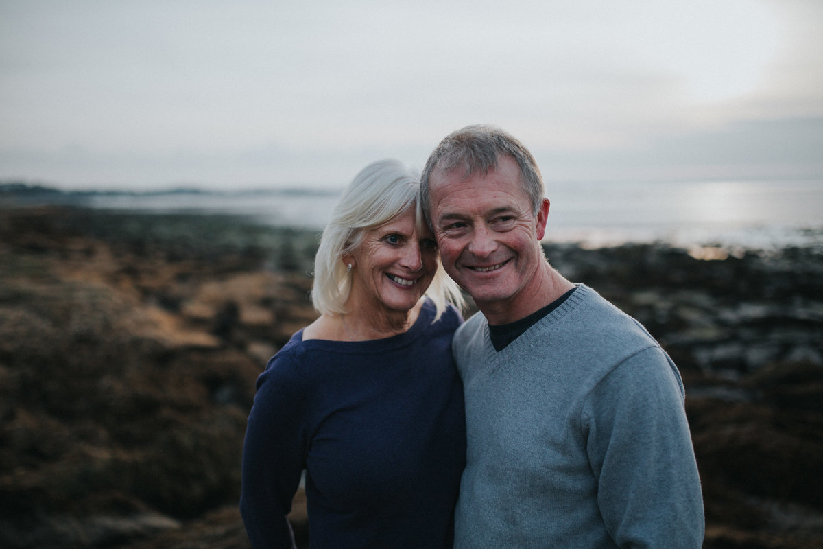 Lancaster Wedding Photographer captures older engaged couple on beach in Heysham