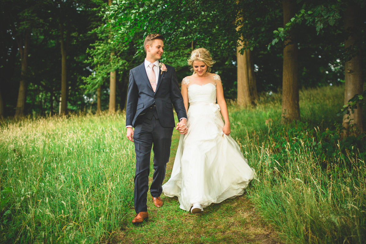 relaxed wedding photography of bride and groom walking and laughing