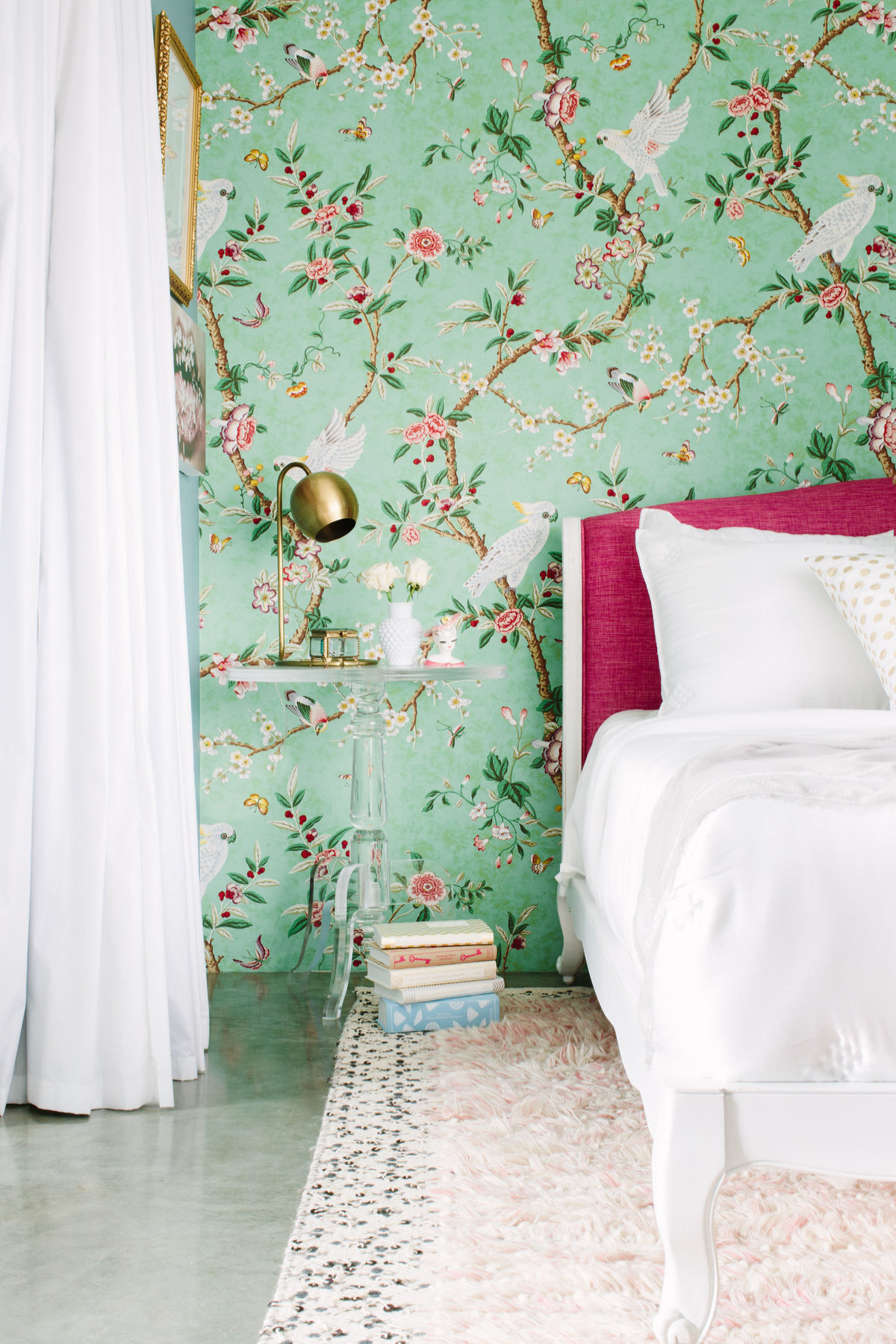 Floral chinoiserie wallpaper bedroom with pink headboard