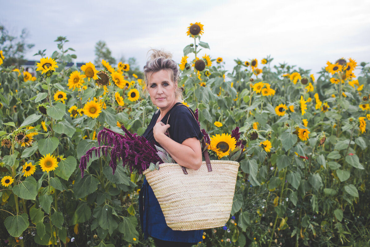lady standing in a sunflower field