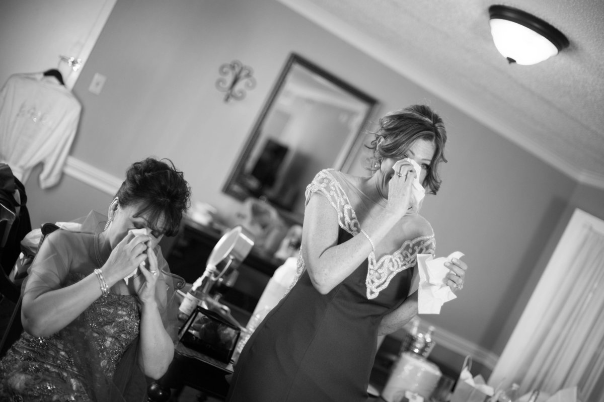 moms seeing bride dressed for first time